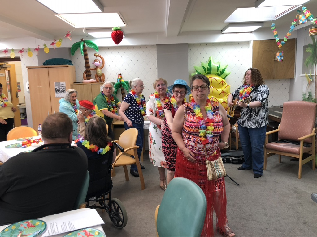 Care home residents dance the conga